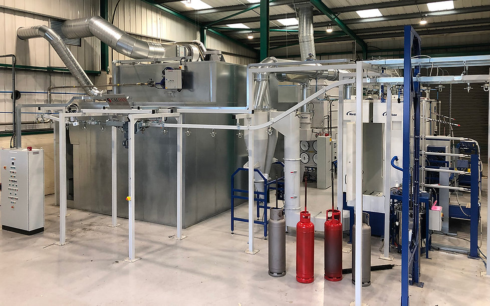 This is a system to powder coat refrigerant cylinders using automatic powder guns and cyclone powder collectors for quick color change.