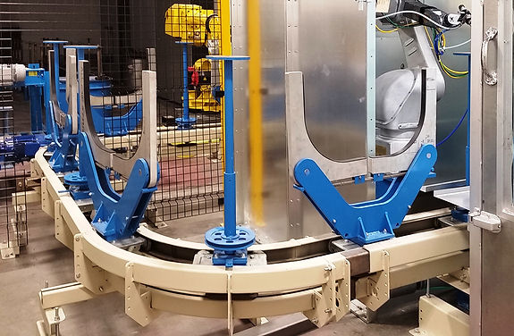 Indexing conveyor for robot painting of truck and auto wheels