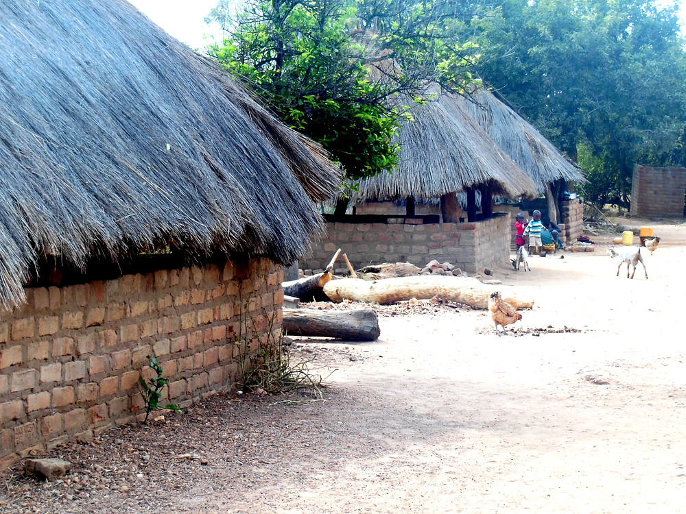 African mud hut with thatched roof