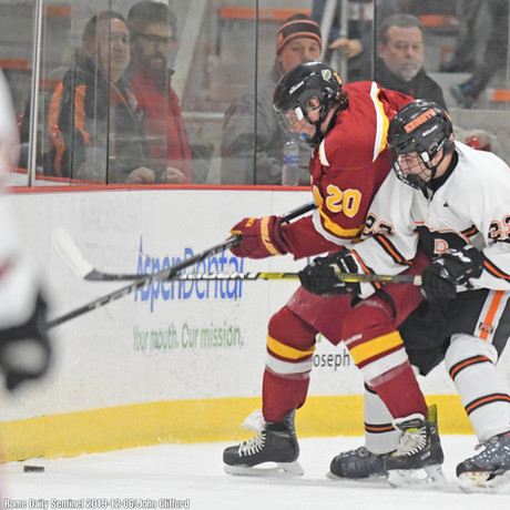 Eychner battles for the puck