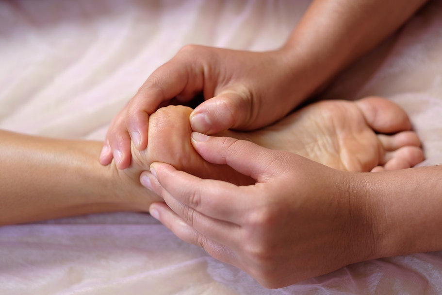 foot-massage-in-the-spa-salon-at-spa-sal