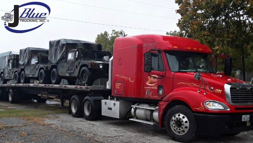 Hauling army vehicles in Kentucky.