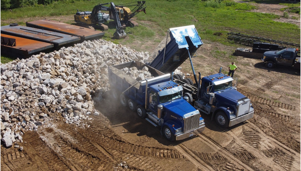 Hauling rock to a levee.
