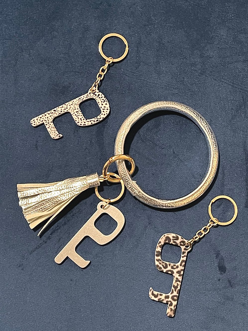 Key ring with door/opener