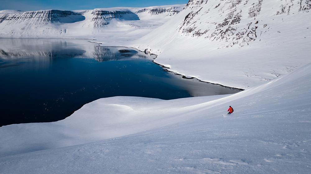 Aurora Arktika ski guide, Kristan, finds some smooth snow above 'no fish fjord'.