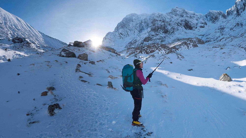 Anne points out lines on the North Face.  CIC hut in the background, along with the classic Tower Ridge and Orion Face.