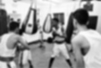 Junior boxers using punch bags