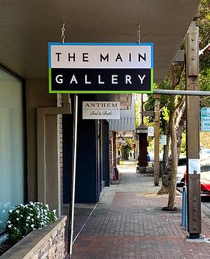 TMG Hanging Sign_MP Ped Walkway_Vert Clo