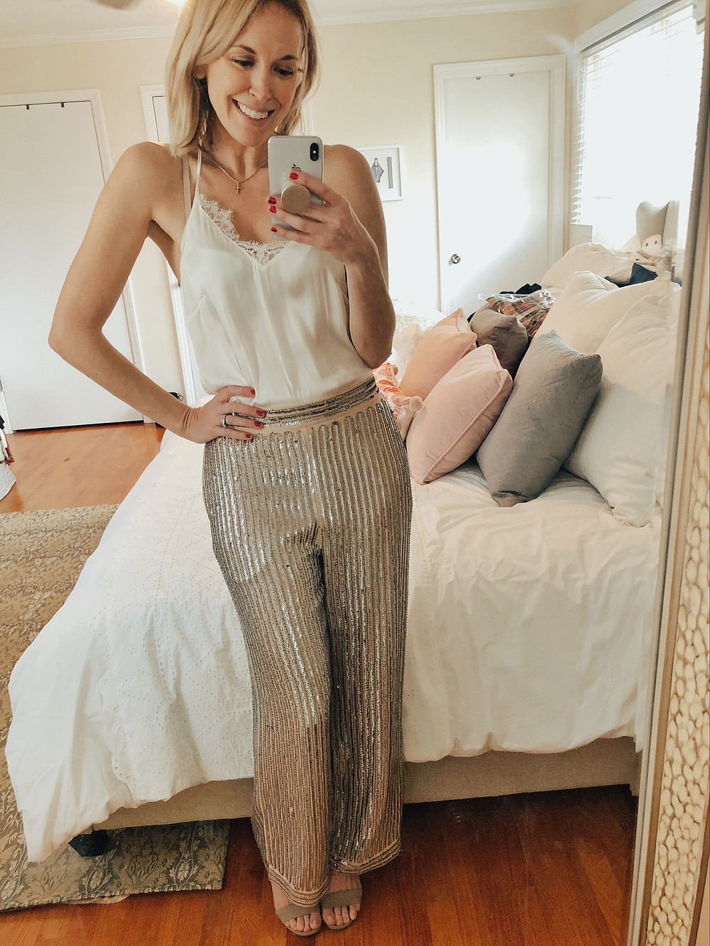Brooke Williams (The Tony Townie) wears sequin wide leg trousers and a silk camisole.