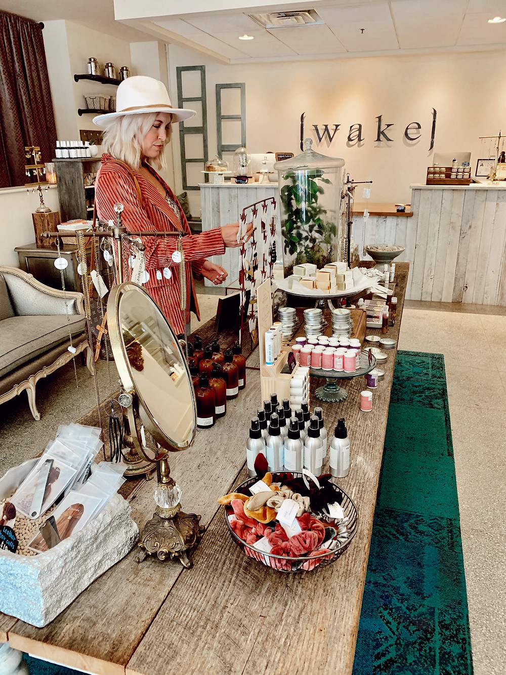 Woman browses jewelry at Wake Foot Sanctuary in the Grove Arcade in Asheville North Carolina. Local travel guide and lifestyle blogger The Tony Townie.