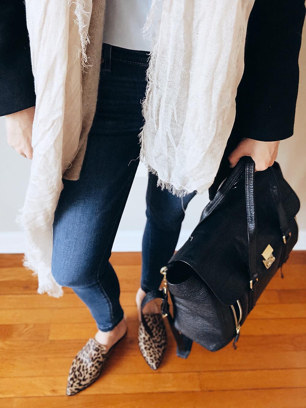 Black Phillip Lim Pashlii bag and leopard flats worn with jeans.