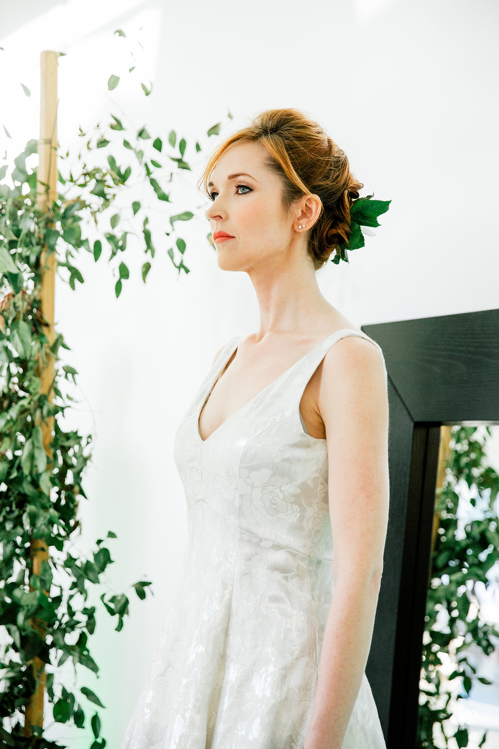 Red head model wears jacquard wedding gown