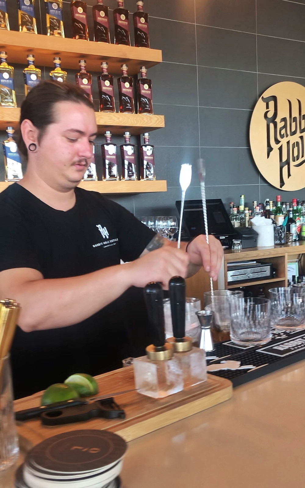 Bartender uses long spoons to make Old Fashioned cocktails at  Rabbit Hole distillery, Urban bourbon trail, Bourbon Trail travel guide, travel blog, best distillery tour