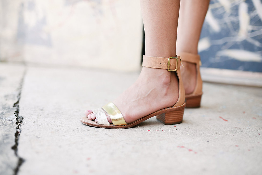 A close-up shot of the Loeffler Randall Henry sandals in gold metallic