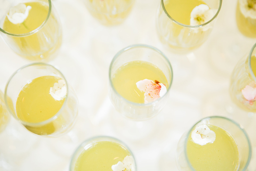 Champagne cocktails with edible flowers floating in the glass