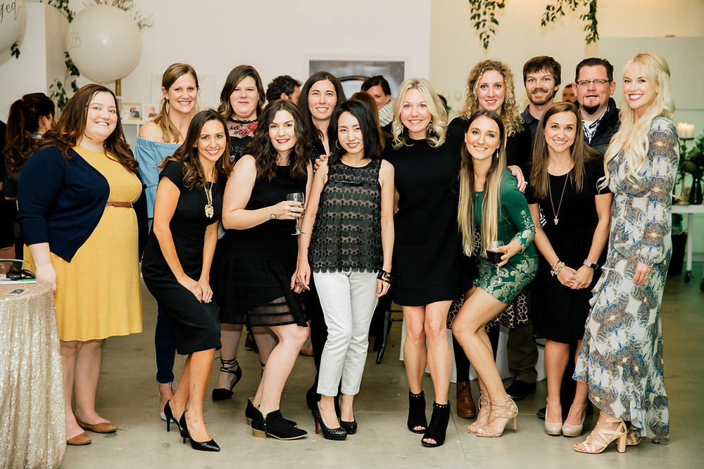 Engaged Studio's creative team huddles for photo at end of launch party
