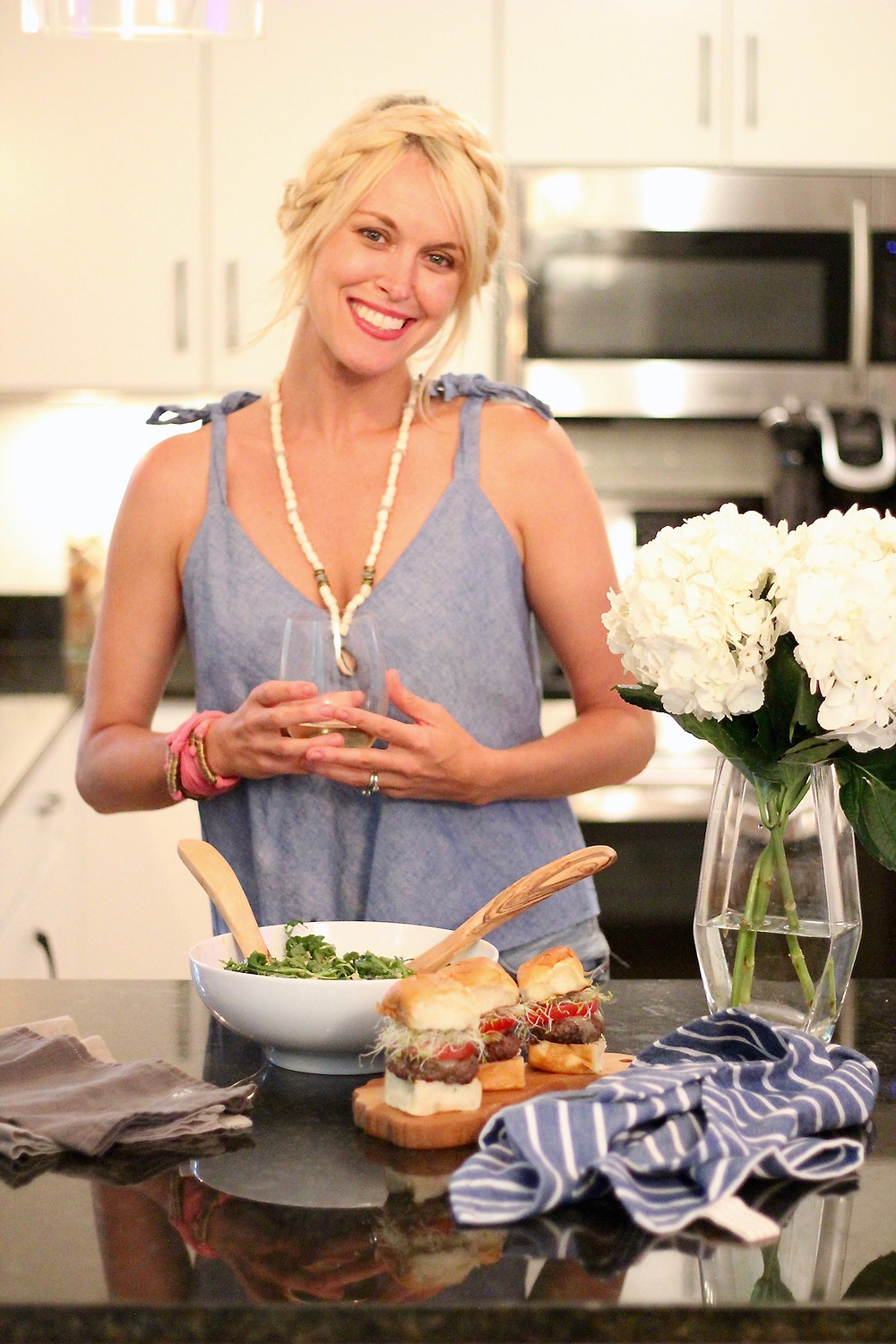 Blogger Brooke Williams smiles as she gets ready to enjoy a summer dinner from The Fresh Market