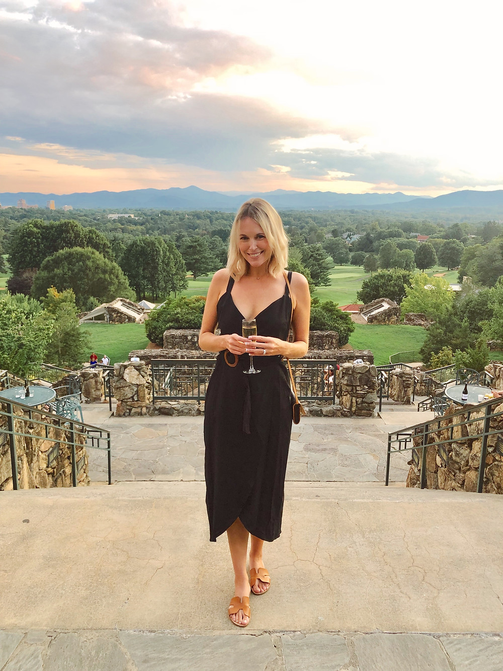 Summer date night outfit: black dress, flat tan sandals, Louis Vuitton crossbody bag. What to wear on romantic getaway to Grove Park Inn in Asheville, NC