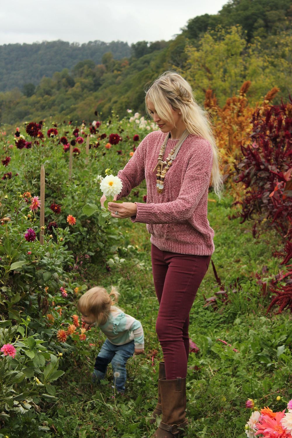 Mom and daughter walk through flower fields at Lady Luck Flower Farm in Asheville, NC.