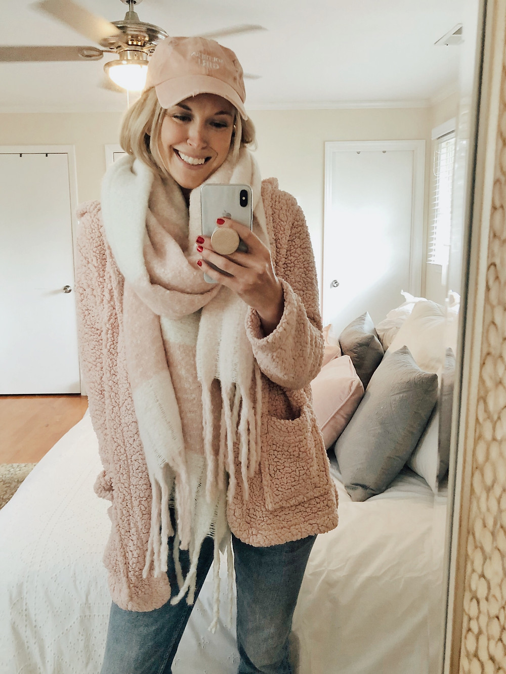 Brooke Williams (The Tony Townie) wears a pink sherpa cardigan with matching pink hat and scarf.