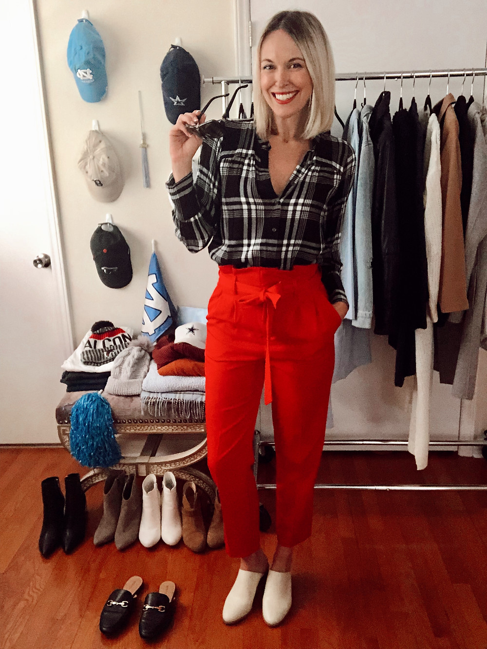 Game day outfit idea, red black white team colors: black plaid shirt, red paper bag trousers, white mules.
