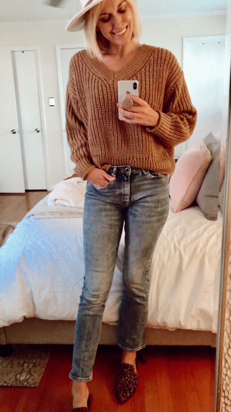 Outfit mirror selfie wearing white rancher hat, copper sweater, blue jeans, and leopard mules