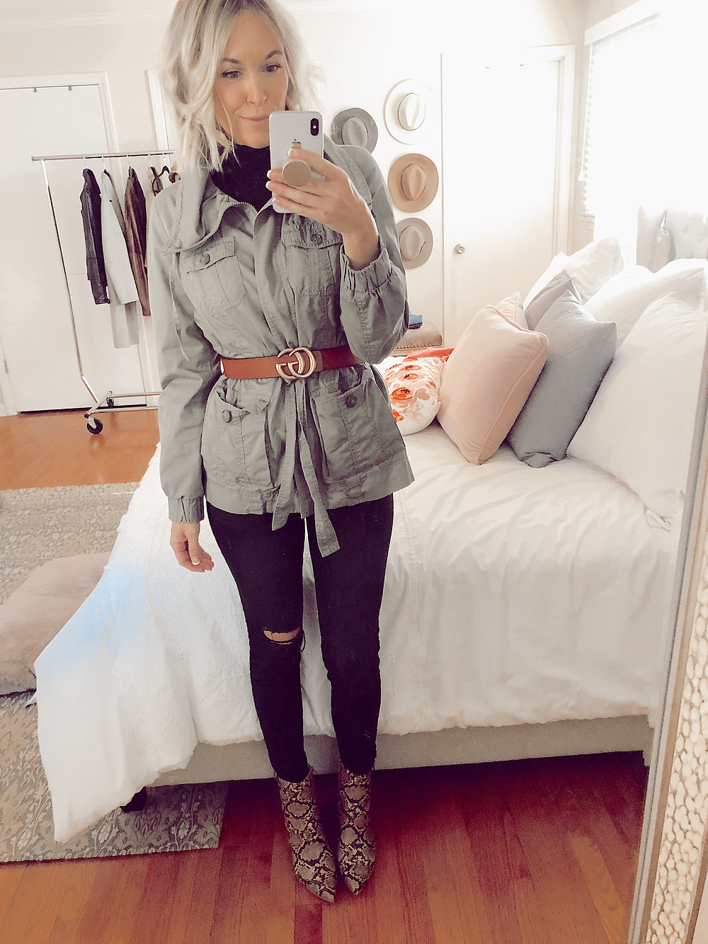 How to style snakeskin booties for fall, belted utility jacket over black turtleneck and black jeans, fall casual outfit ideas, style tips for women, fashion blog