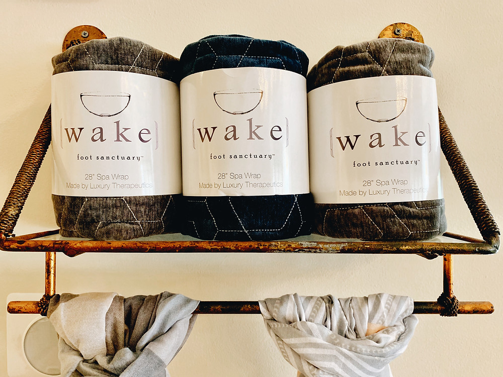 Spa wraps sit on a shelf at Wake Foot Sanctuary at the Grove Arcade in Asheville North Carolina. Local travel guide and lifestyle blogger The Tony Townie.