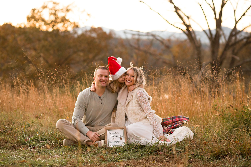 Dressy family Christmas card idea with reindeer antlers and santa hat.