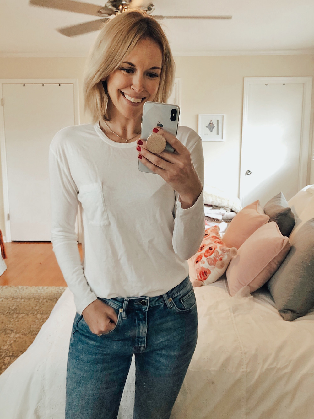 Brooke Williams (The Tony Townie) wears a white pocket t-shirt and jeans.