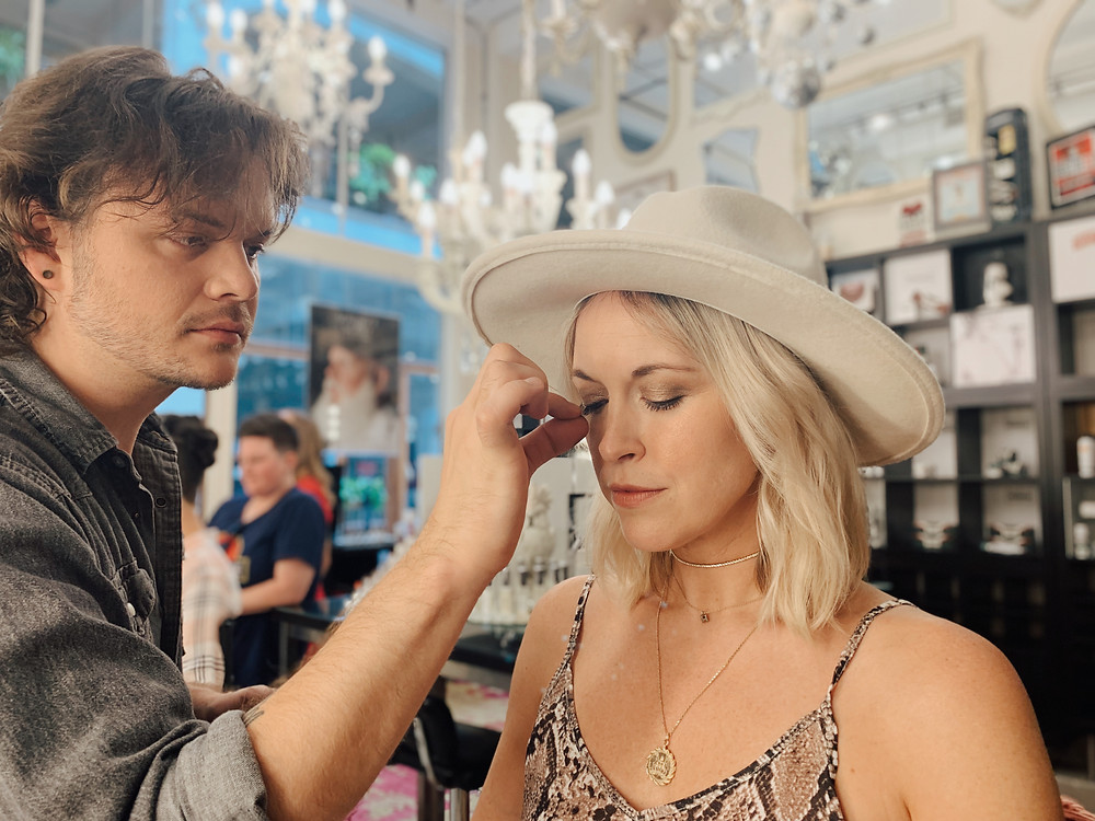 Esthetician applies lashes to woman at Serenity + Scott Apothecary in Grove Arcade in Asheville North Carolina. Local travel guide and lifestyle blogger The Tony Townie.