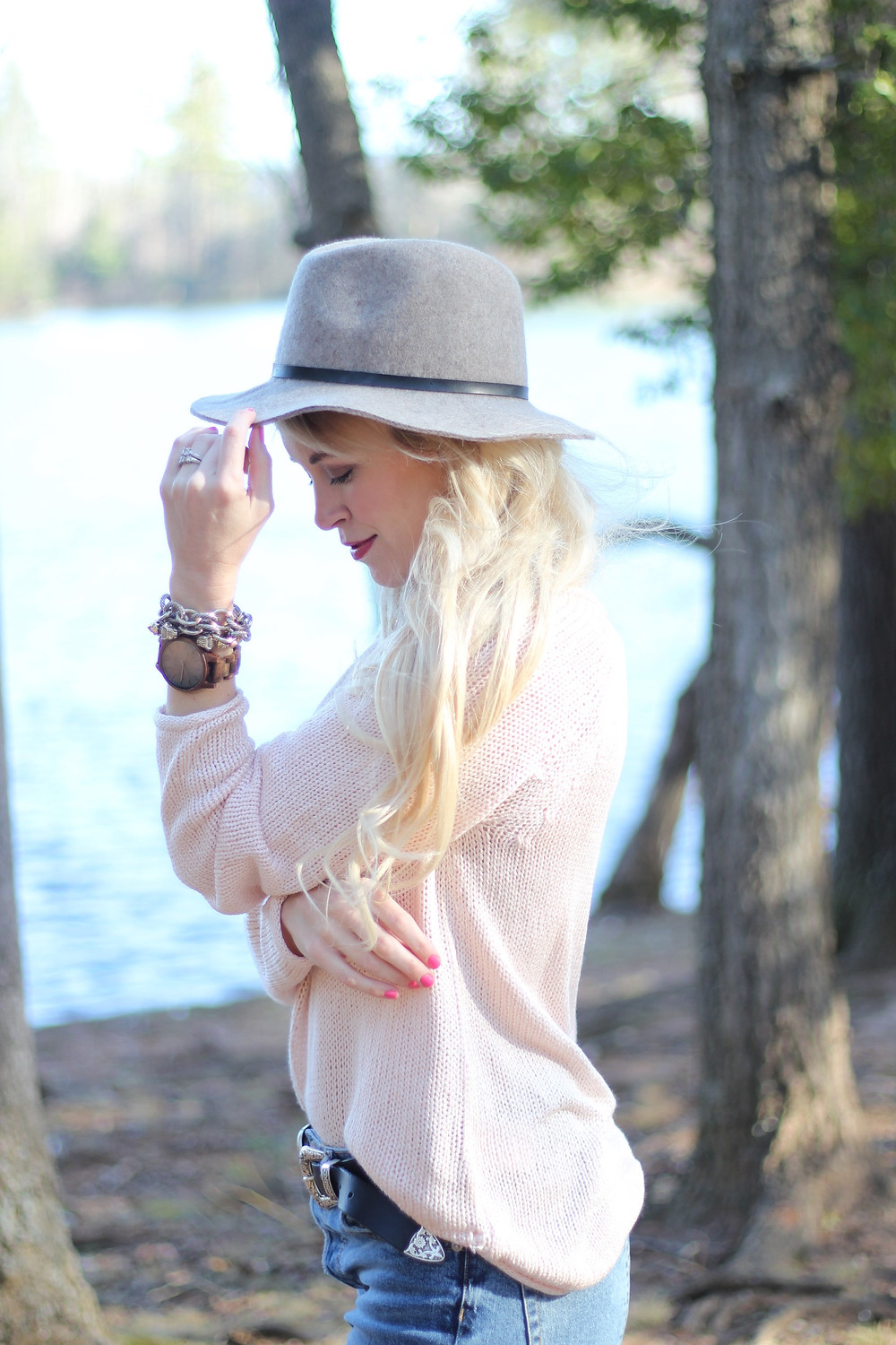 A young mother in a blush pink sweater wears a JORD Wood Watch to keep track of life's precious moments.