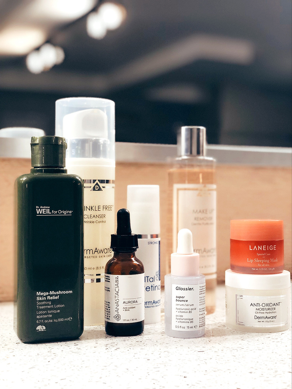 Detail shot of skin care products including Glossier  super bounce and Dr Andrew Weil Mega-Mushroom Skin Relief.