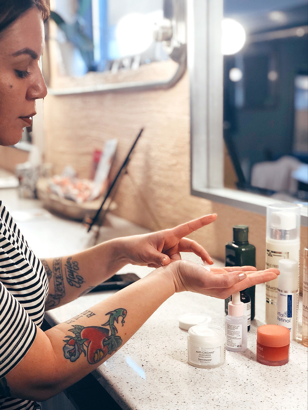 Jenna Clifford dabs finger in skin care serums at Gaze Lash and Brow Bar.