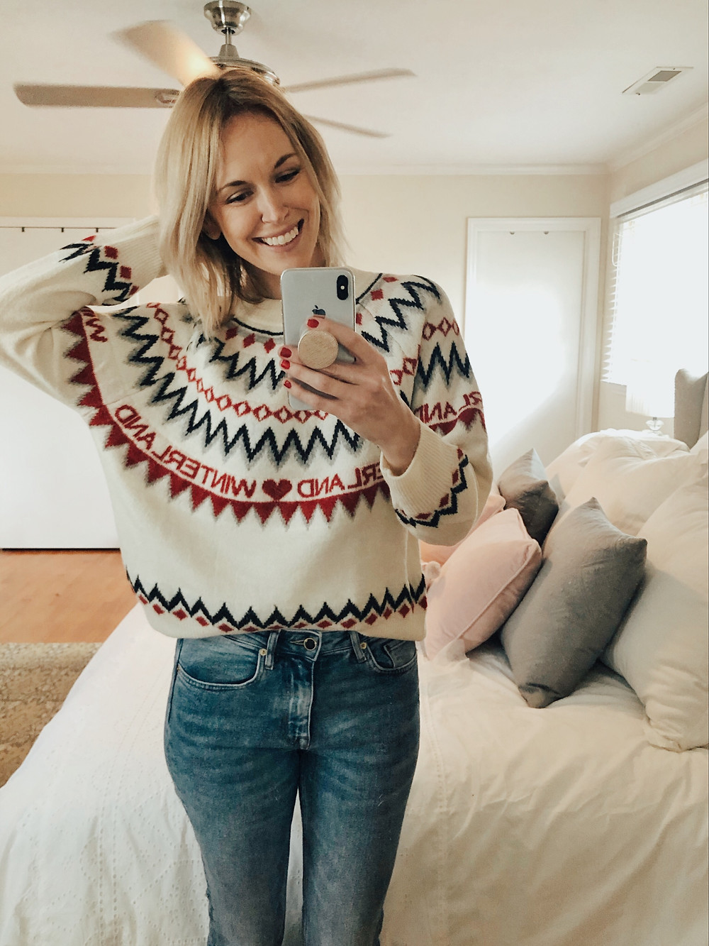 Brooke Williams (The Tony Townie) wears a Winterland fair isle Christmas sweater and jeans.