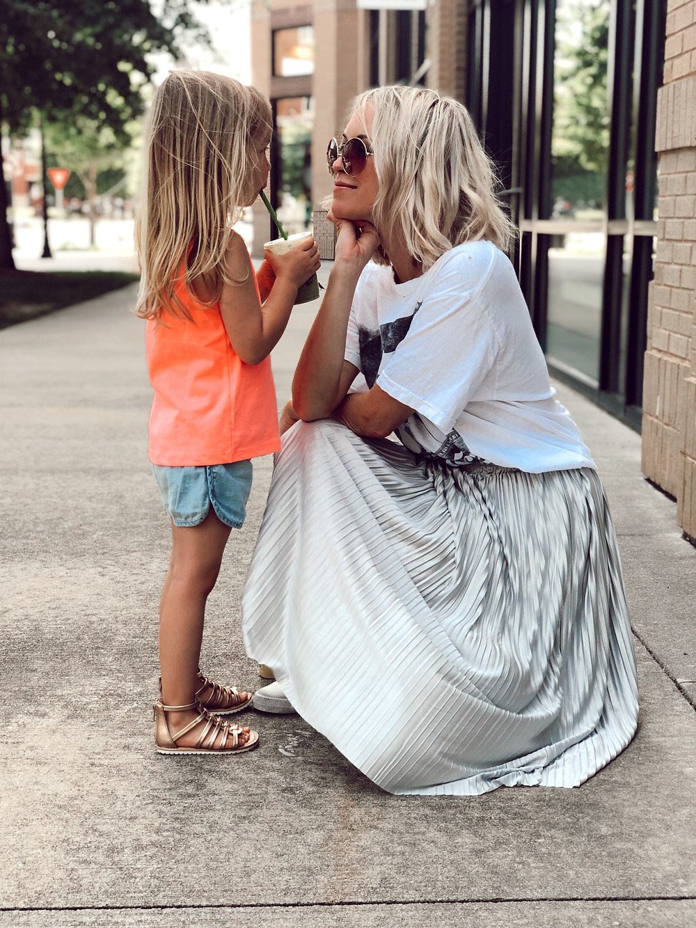 Mom style, skirt and sneakers, Black white t-shirt, metallic pleated skirt, Golden Goose dupe sneakers, round sunglasses, summer outfit, budget style