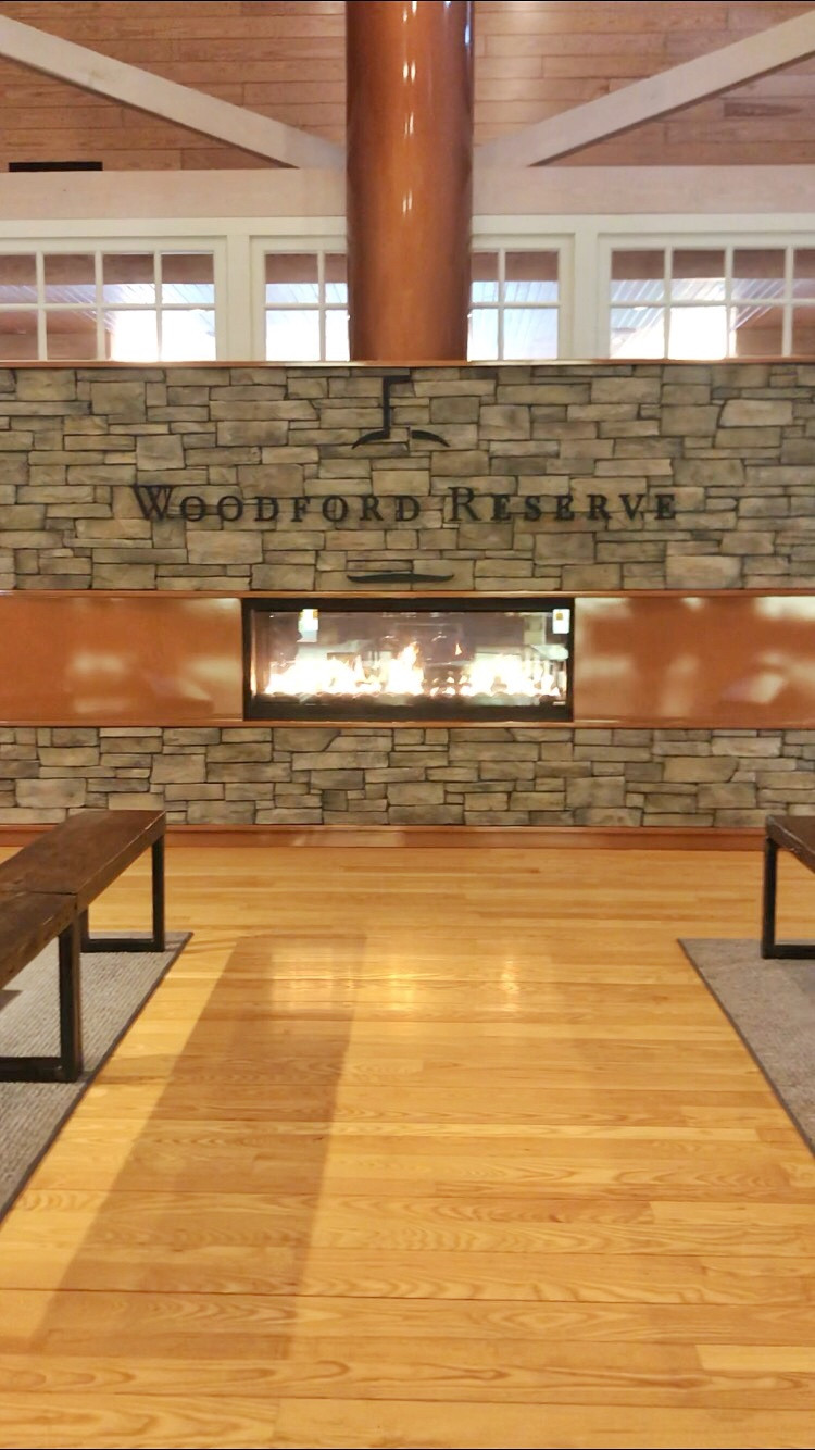 Fireplace built into rock wall at Woodford Reserve distillery in Versailles Kentucky, Bourbon Trail travel guide, best bourbon distilleries travel guide, travel blog