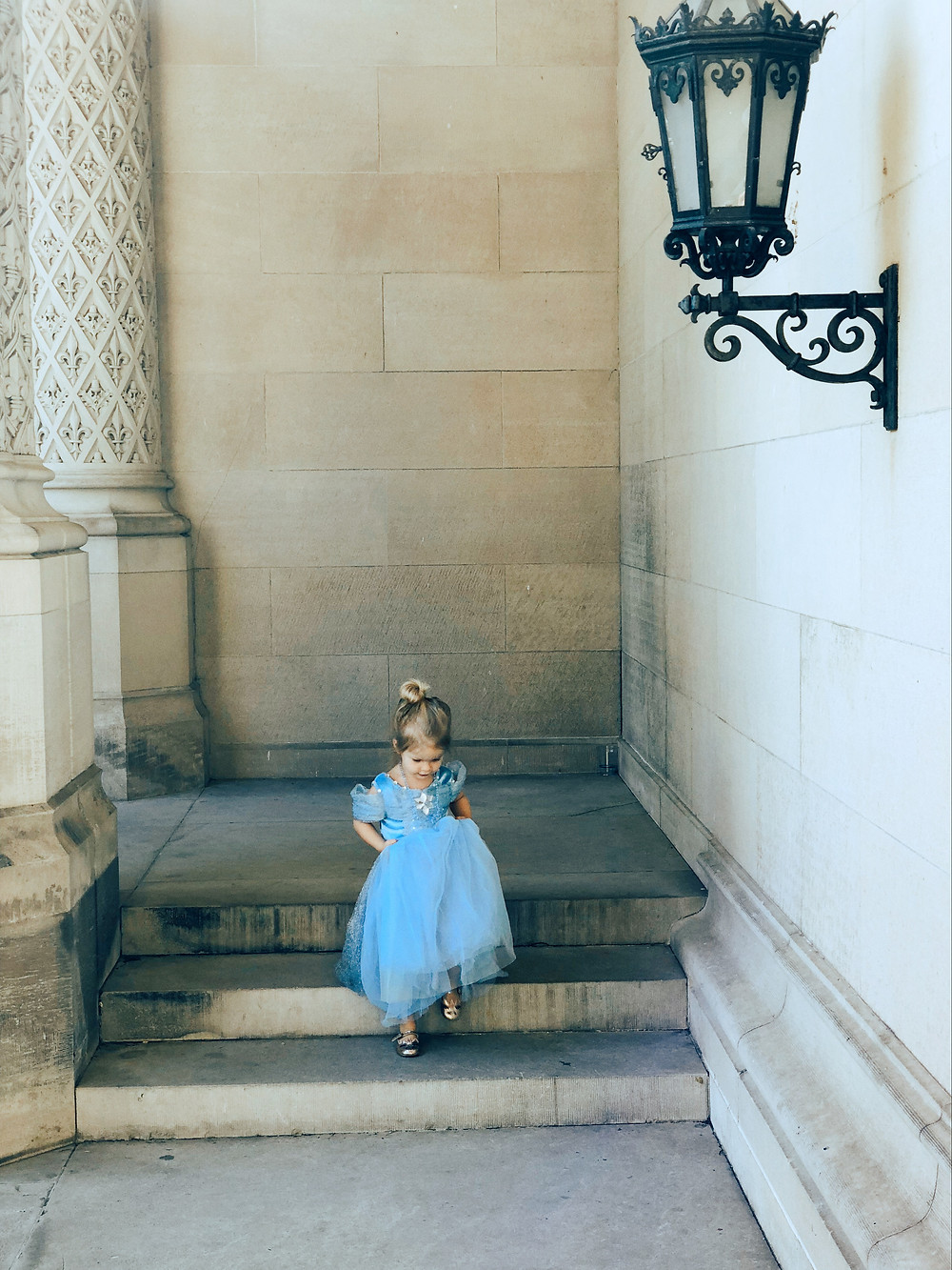 A little girl dressed as Cinderella plays at the Biltmore House.