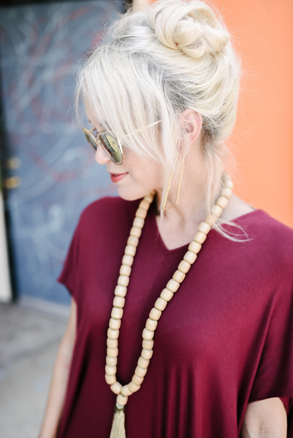 Brooke from The Tony Townie fashion/lifestyle blog wears Yana K burgundy tunic dress with wooden bead necklace by Sweet Tea Bohemian and Rachel Weisberg earrings in downtown Asheville