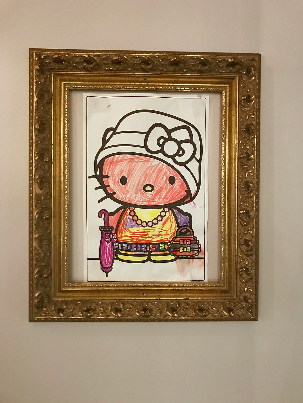 hello Kitty framed artwork at Dilworth Tasting Room in Charlotte NC