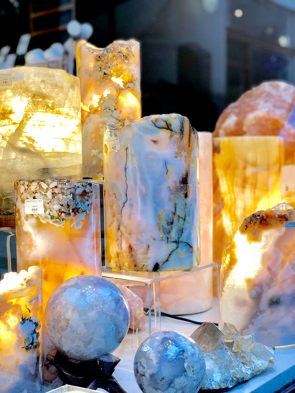Cylindrical rocks are lit from within at Enter The Earth in the Grove Arcade in Asheville North Carolina. Local travel guide and lifestyle blogger The Tony Townie.