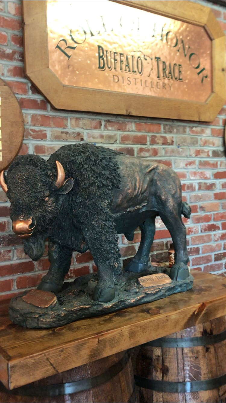 Statue of buffalo sits in front of Roll of Honor sign at Buffalo Trace gift shop, best bourbon distilleries, travel guide, travel blog