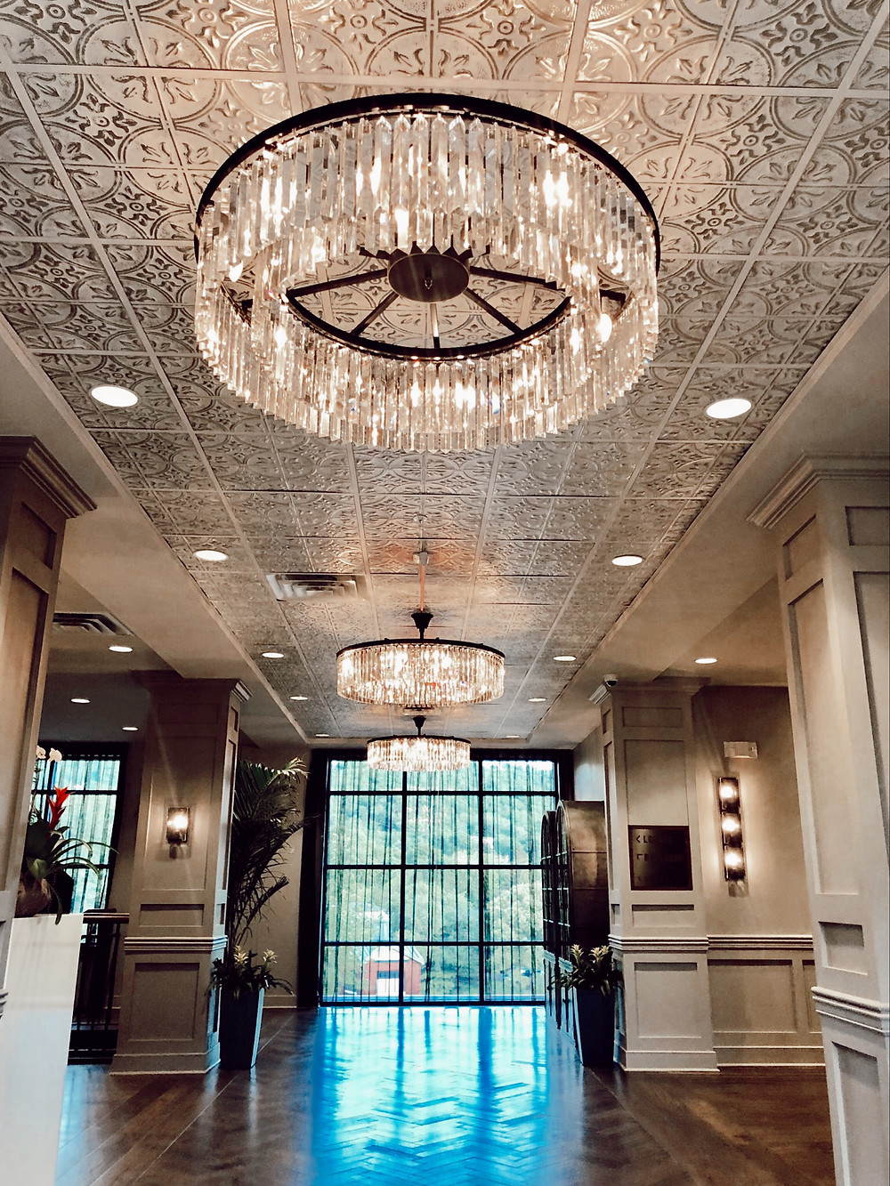 Crystal chandeliers in lobby of Foundry Hotel Asheville NC