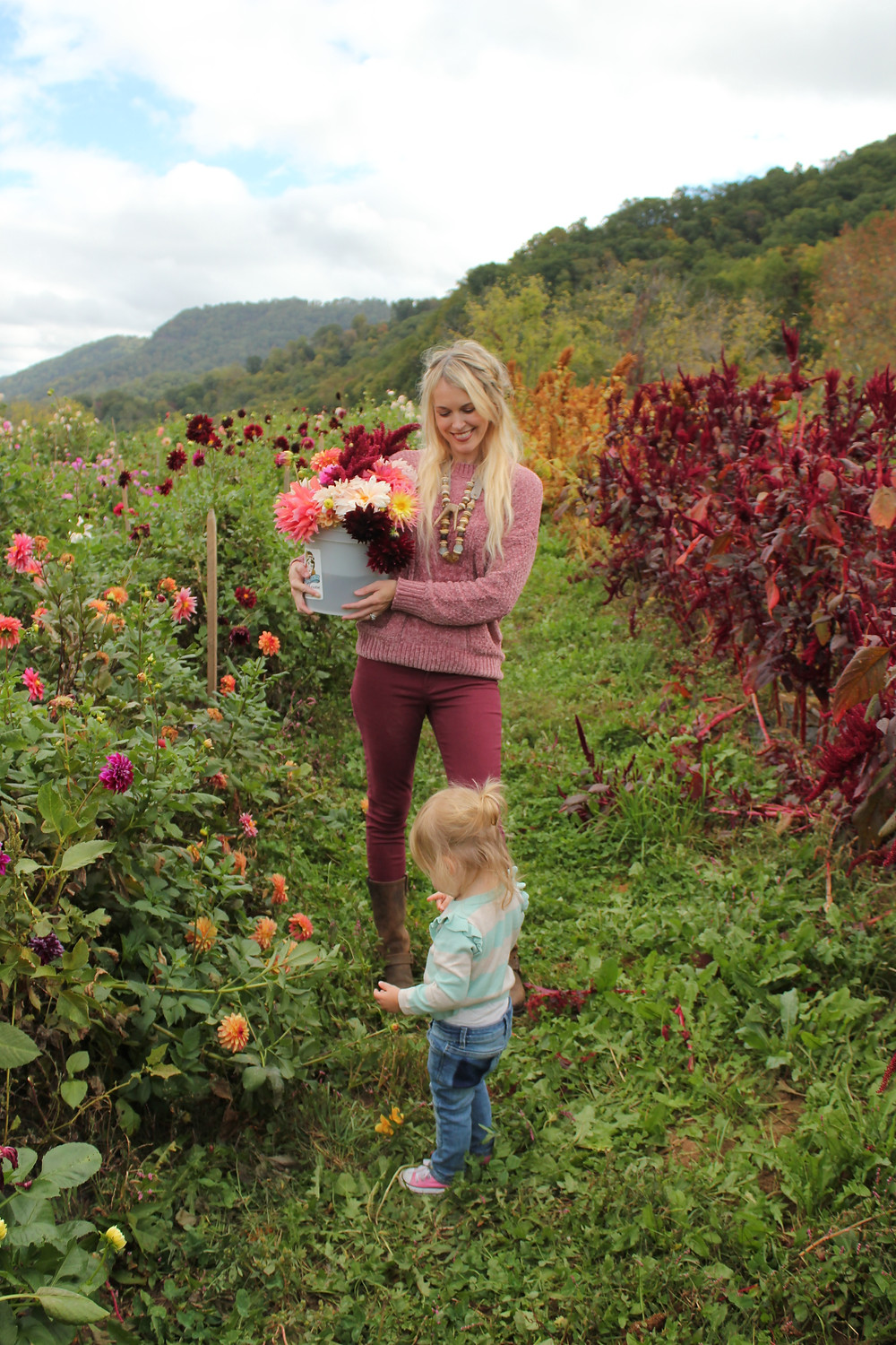 Brooke smiles at Harlow as they walk through Lady Luck Flower Farm in Asheville, NC.