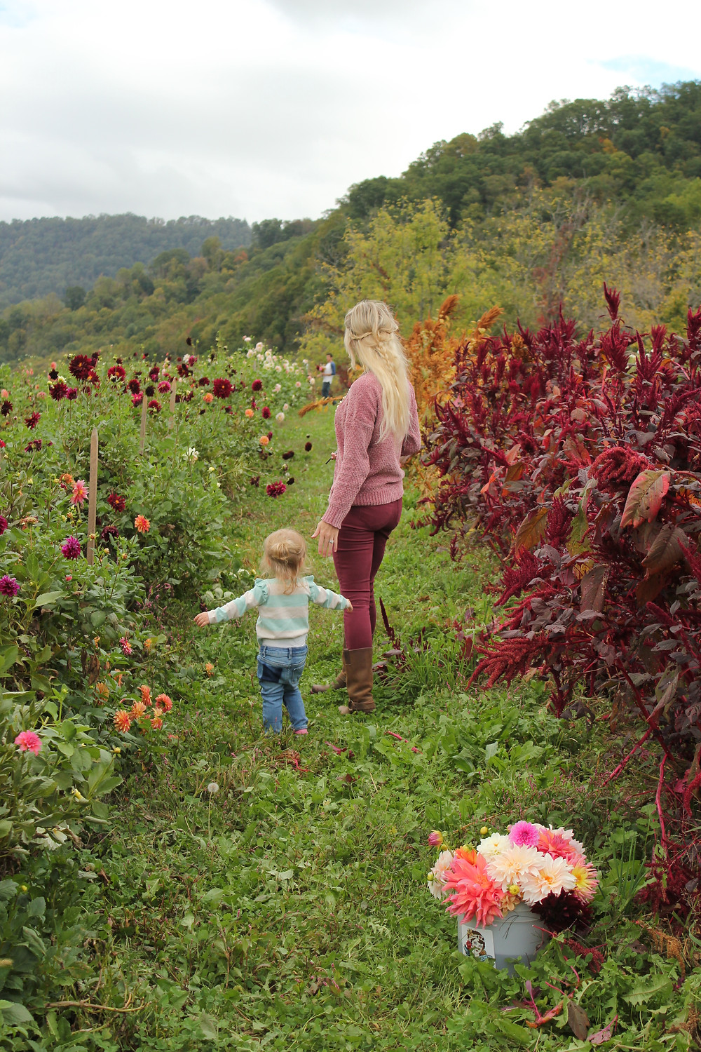 Mom and daughter admire the flowers at Lady Luck Flower Farm in Asheville, NC.