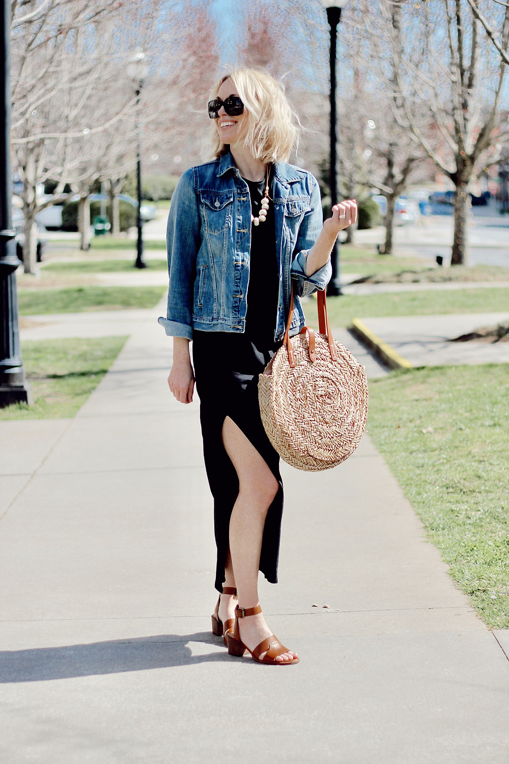 black maxi dress, denim jacket, straw round tote bag
