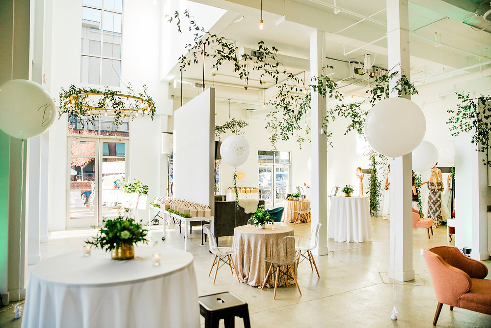 Engaged Wedding Studio decorated in greenery and white balloons for their 2017 Launch Party