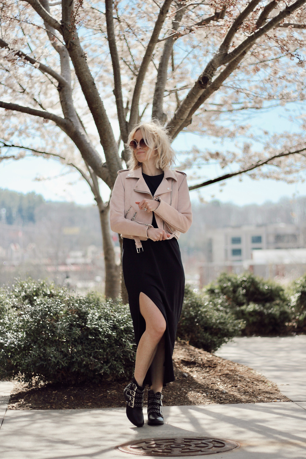 black maxi dress, pink moto jacket, studded boots