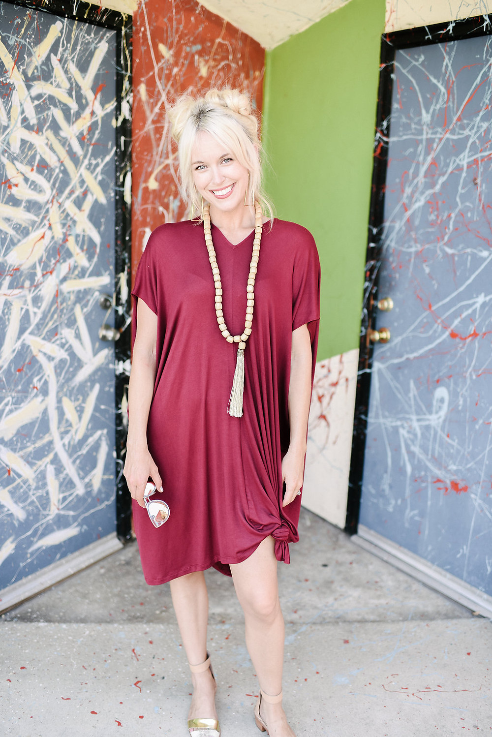 Brooke from The Tony Townie fashion/lifestyle blog wears burgundy tunic dress with wooden bead necklace