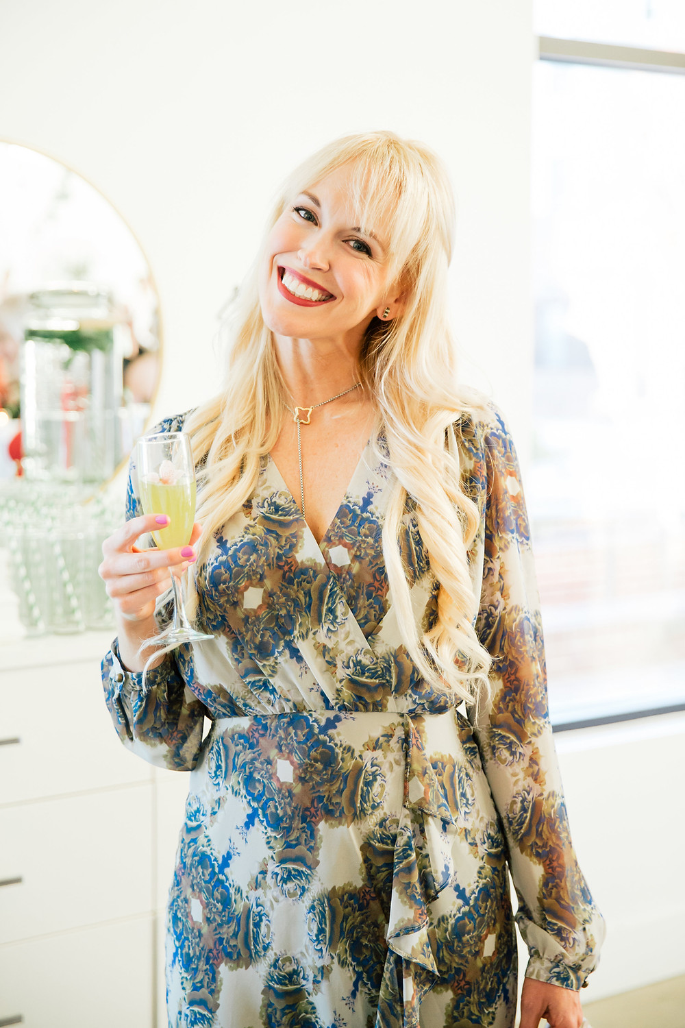 Stylist and lifestyle blogger Brooke Williams sips a cocktail while she mingles at Engaged's Launch Party